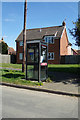 TM3555 : Telephone Box on School Road by Adrian Cable