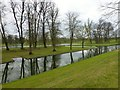 SP8981 : Boughton House - Reflections in Dead Reach by Richard Humphrey