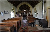 ST5906 : Melbury Bubb, St. Mary's Church: The nave showing the coal fire for heating by Michael Garlick