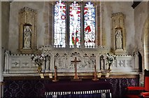 ST5906 : Melbury Bubb, St. Mary's Church: The chancel with its carved reredos and odd faux niches by Michael Garlick