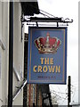 TM0459 : The hanging sign of 'The Crown' public house by Adrian S Pye