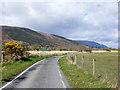 NN1681 : Minor road near to River Lochy by Trevor Littlewood