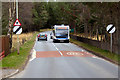 NH9022 : Bus arriving at Carrbridge by David Dixon