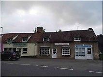 TL5646 : Shops on High Street, Linton by David Howard