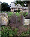 SO6026 : Kissing gate entrance to the village churchyard, Brampton Abbotts, Herefordshire by Jaggery