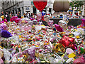 SJ8398 : Floral Tributes at St Ann's Square by David Dixon