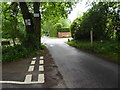 SU8329 : Looking south on the road through Liphook Golf Course by Shazz