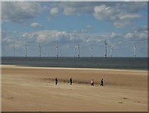 NZ6025 : Walking on the beach at Redcar by Neil Theasby
