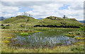 NY3402 : Infilling tarn with knolls by Trevor Littlewood