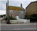 SY4690 : Semi-detached cottages and a white picket fence, West Bay by Jaggery