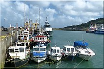 SW4628 : Boats moored in Newlyn Harbour by Robin Drayton