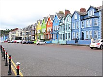 J4791 : Brightly painted houses on Marine Parade, Whitehead by Eric Jones