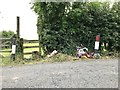 SJ8054 : Roadside memorial and stile near Alsager by Jonathan Hutchins
