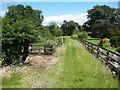 SE2847 : Footpath through a garden, Weeton by Humphrey Bolton