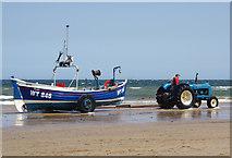 NZ6025 : Boat hauling - Redcar Beach by Stephen McKay