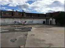 TL0450 : Graffiti on the car park wall by Philip Jeffrey
