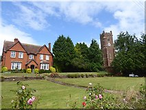 SX9792 : House and church, Sowton by David Smith