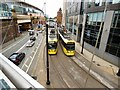 SJ8497 : Passing trams by Gerald England