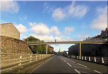 SH4862 : Footbridge over A487 by John Firth