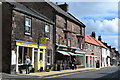 NT9928 : Shops in Wooler High Street by David Martin