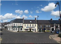 J4569 : Businesses at the junction of High Street and Castle Street. Comber by Eric Jones