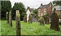 NY0106 : Gravestones at St. John's Church, Beckermet by Trevor Littlewood