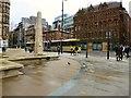 SJ8398 : Cenotaph, tram, people, pigeon by Gerald England