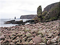 NC1964 : Boulders at shore of Port Mòr by Trevor Littlewood