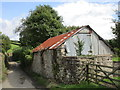 SX7773 : Stone and corrugated iron shed at Sigford by Jonathan Thacker