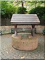 TQ2904 : Well in St Ann's well gardens by Paul Gillett