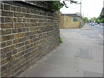 TQ1469 : The Stockyard Wall, Hampton Court Road, and a bench mark by John S Turner