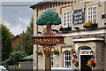 TL9165 : Thurston Village sign by Adrian Cable