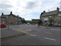 SK2572 : Bus stop on A623 in Baslow by David Smith