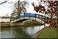 SP5105 : Footbridge at the confluence of the River Cherwell and River Thames by Steve Daniels