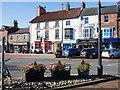 SE3693 : Shops beyond flower tubs in Northallerton by Trevor Littlewood