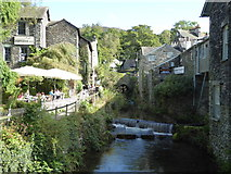 NY3704 : Ambleside - weir and former mills by Chris Allen