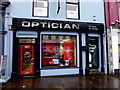 H4572 : Optician with red door, Omagh by Kenneth  Allen