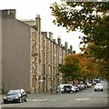 NT2675 : Tenements and autumn leaves by Alan Murray-Rust