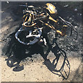SP3682 : Burnt-out motorbike, Wood End by Robin Stott