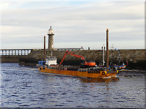 NZ8911 : Dredger 'Sandsend' in Whitby Harbour by David Dixon