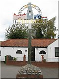 TG2834 : Trunch Village Sign by G Laird