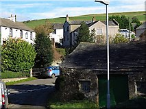 NY2436 : Uldale village by Andrew Curtis