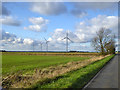 TL2463 : View towards Cotton Farm wind farm by Robin Webster