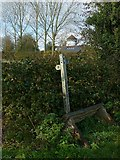 SK3030 : Footpath fingerpost at the junction of Little Derby Way and Airport Way by Alan Murray-Rust