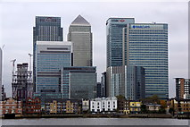 TQ3880 : Houses at Coldharbour dwarfed by Canary Wharf by Mike Pennington