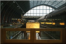 TQ3083 : View of lights in Searcy's coffee bar reflected in the side of a Class 374 Eurostar in St. Pancras Station by Robert Lamb