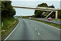 SJ1974 : Footbridge over the North Wales Expressway near Milwr by David Dixon