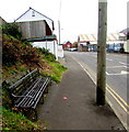 ST0090 : Roadside bench near a Williamstown boundary sign by Jaggery
