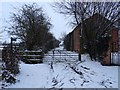 SK2832 : Snowy trackway and footpath by Ian Calderwood