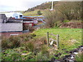 SE0929 : Redundant stiles on Queensbury FP31 by Humphrey Bolton